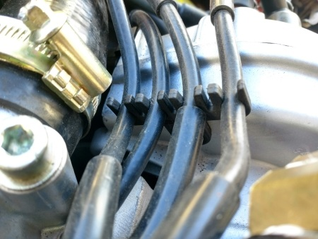 944 spark plug wire loom in place on engine
